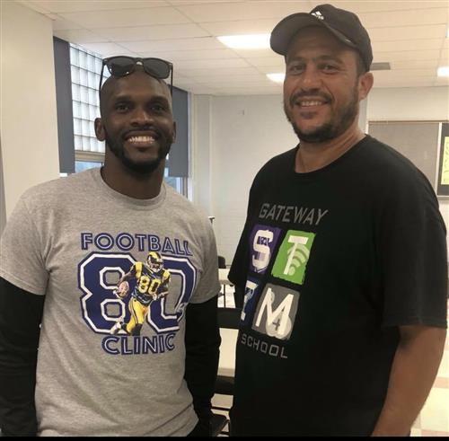 Working with St. Louis Ram's legend Isaac Bruce on his Free Football Camp at Gateway STEM High School